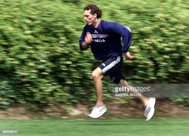French defender Laurent Blanc runs 04 July in Clairefontaine near Paris during a training session with his national soccer team France will play 08...