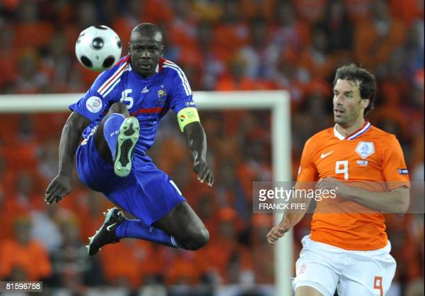 French defender Lilian Thuram jumps to control the ball next to Dutch forward Ruud van Nistelrooy during the Euro 2008 Championships Group C football...