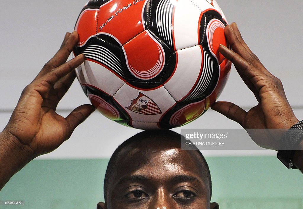 French defender Mouhamadou Dabo poses with a football ball during his official presentation as Sevilla's new player, on May 25, 2010 in Sevilla. Dabo, 23, sign a four-year contract with Sevilla.