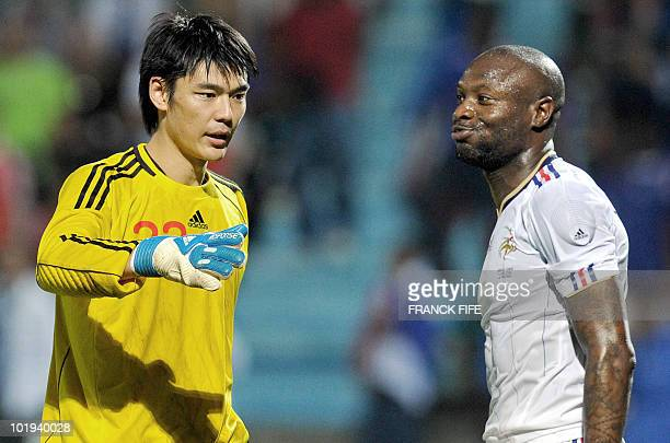French defender William Gallas reacts next to China's goalkeeper Zeng Cheng at the end at the end of the friendly football match France vs China at...