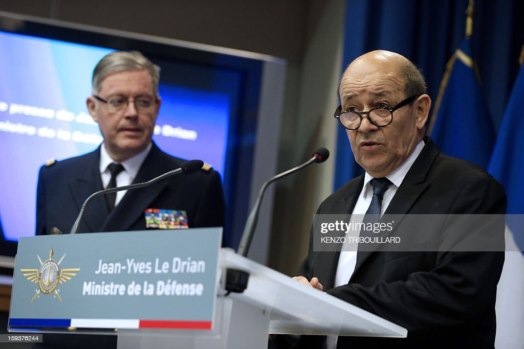 French Defense Minister Jean-Yves Le Drian (R) flanked by French army chief of staff Admiral Edouard Guillaud, gives a press conference on January 12, 2013 in Paris about a French pilot, who was killed during a helicopter raid to prevent Islamist groups controlling northern Mali from advancing toward the capital Bamako. The raid was carried out on January 11 to support Mali ground troops in the battle for the key town of Kona. Backed by French air power, Malian troops on January 11 unleashed an offensive against Islamist rebels who, having seized control of the north of the country in March last year, were threatening to push south. AFP PHOTO / KENZO TRIBOUILLARD