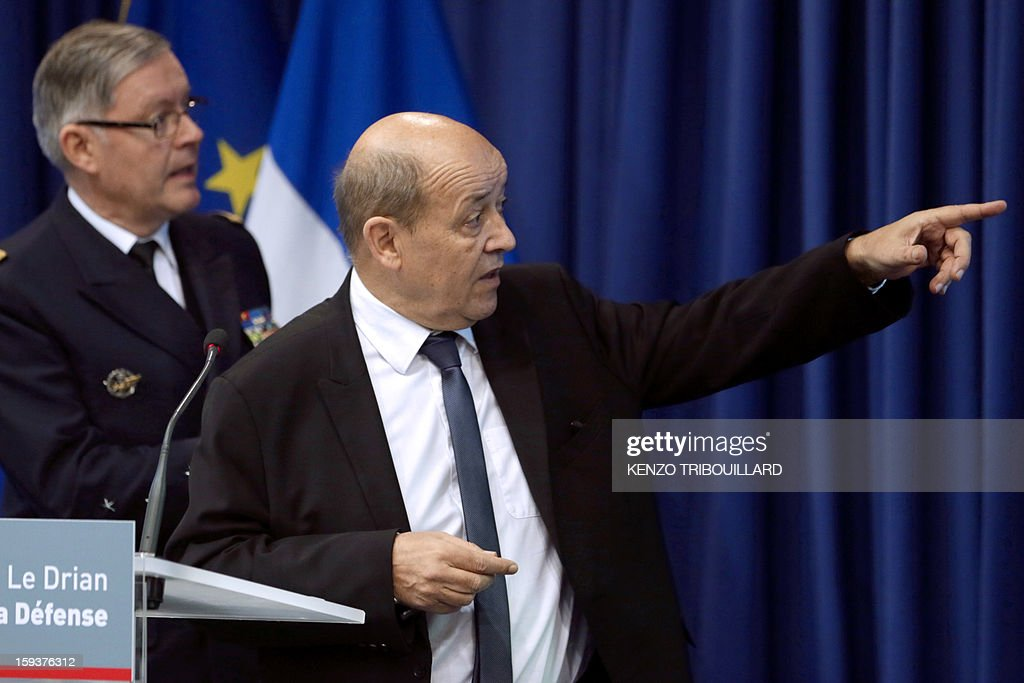 French Defense Minister Jean-Yves Le Drian (R), flanked by French army chief of staff, Admiral Edouard Guillaud, gestures during a press conference on January 12, 2013 in Paris. Le Drian said that a French pilot was killed on January 11 during a helicopter raid to prevent Islamist groups controlling northern Mali from advancing toward the capital Bamako. The raid was carried out to support Mali ground troops in the battle for the key town of Kona. Backed by French air power, Malian troops on January 11 unleashed an offensive against Islamist rebels who, having seized control of the north of the country in March last year, were threatening to push south. AFP PHOTO / KENZO TRIBOUILLARD