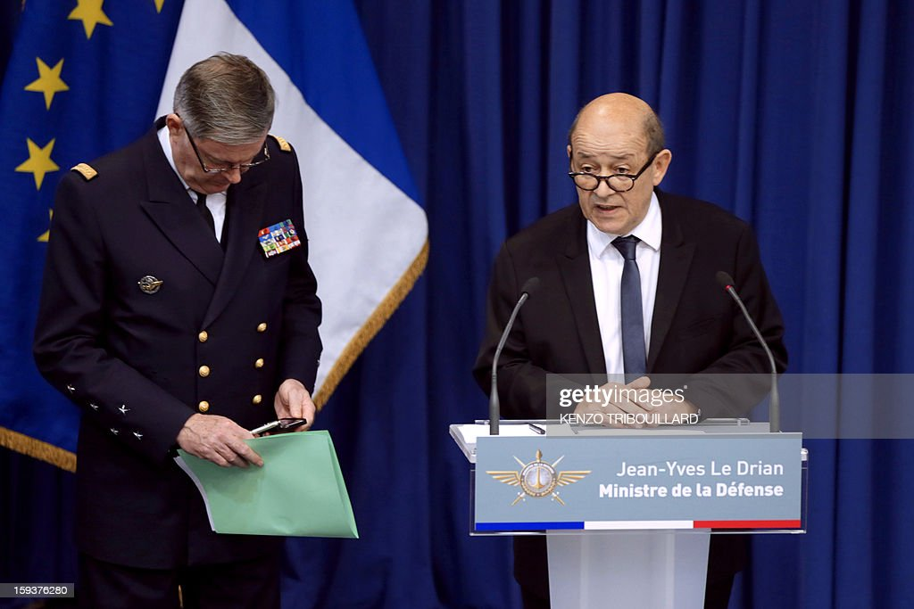 French Defense Minister Jean-Yves Le Drian (R) gestures during a press conference on January 12, 2013 in Paris. Le Drian said that a French pilot was killed on January 11 during a helicopter raid to prevent Islamist groups controlling northern Mali from advancing toward the capital Bamako. The raid was carried out to support Mali ground troops in the battle for the key town of Kona. Backed by French air power, Malian troops on January 11 unleashed an offensive against Islamist rebels who, having seized control of the north of the country in March last year, were threatening to push south. AFP PHOTO / KENZO TRIBOUILLARD