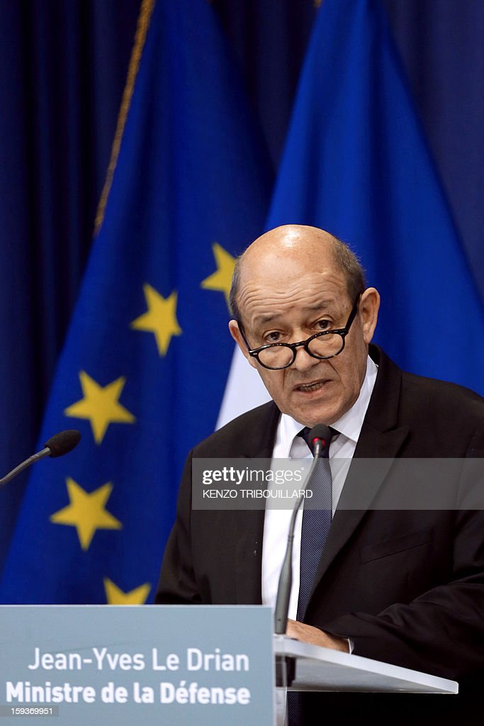 French Defense Minister Jean-Yves Le Drian (C) gives a press conference on January 12, 2013 in Paris. Le Drian said that a French pilot was killed on January 11 during a helicopter raid to prevent Islamist groups controlling northern Mali from advancing toward the capital Bamako. The raid was carried out to support Mali ground troops in the battle for the key town of Kona. Backed by French air power, Malian troops on January 11 unleashed an offensive against Islamist rebels who, having seized control of the north of the country in March last year, were threatening to push south. AFP PHOTO / KENZO TRIBOUILLARD