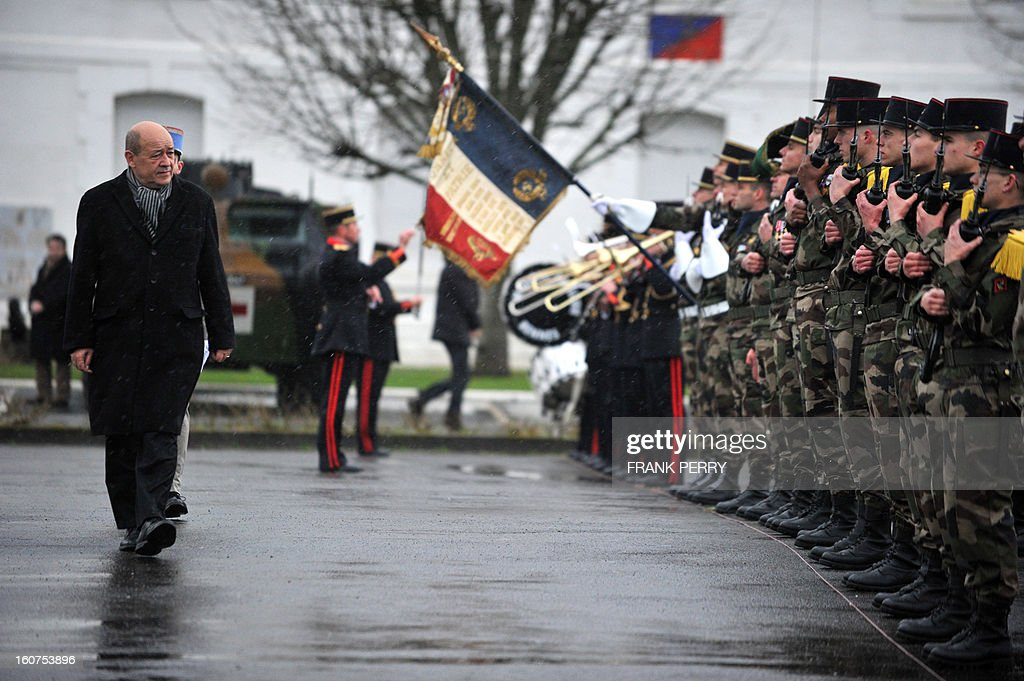 French Defense Minister Jean-Yves Le Drian reviews 3rd Marine Infantry Regiment troops on February 5, 2013 in the northwestern French city of Vannes. After a three-week campaign by French-led forces drove Islamist extremists from most of their strongholds in northern Mali, including the cities of Timbuktu and Gao, dozens of French warplanes carried out major air strikes on rebel training and logistics centres on February 3 in Mali's mountainous northeast, near the Algerian border. France is eager to pass the baton in Mali to some 8,000 African troops pledged for the UN-backed AFISMA force, still deploying at a snail's pace, after sweeping to its former colony's aid on January 11 as the Islamists threatened to advance south towards the capital Bamako. AFP PHOTO / FRANK PERRY