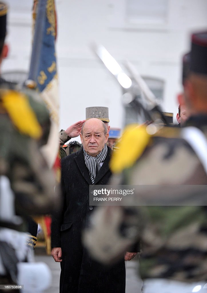 French Defense Minister Jean-Yves Le Drian reviews 3rd Marine Infantry Regiment troops on February 5, 2013 in the northwestern French city of Vannes. After a three-week campaign by French-led forces drove Islamist extremists from most of their strongholds in northern Mali, including the cities of Timbuktu and Gao, dozens of French warplanes carried out major air strikes on rebel training and logistics centres on February 3 in Mali's mountainous northeast, near the Algerian border. France is eager to pass the baton in Mali to some 8,000 African troops pledged for the UN-backed AFISMA force, still deploying at a snail's pace, after sweeping to its former colony's aid on January 11 as the Islamists threatened to advance south towards the capital Bamako.