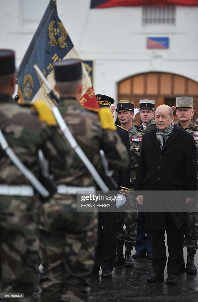 French Defense Minister Jean-Yves Le Drian (2nd R) reviews 3rd Marine Infantry Regiment troops on February 5, 2013 in the northwestern French city of Vannes. After a three-week campaign by French-led forces drove Islamist extremists from most of their strongholds in northern Mali, including the cities of Timbuktu and Gao, dozens of French warplanes carried out major air strikes on rebel training and logistics centres on February 3 in Mali's mountainous northeast, near the Algerian border. France is eager to pass the baton in Mali to some 8,000 African troops pledged for the UN-backed AFISMA force, still deploying at a snail's pace, after sweeping to its former colony's aid on January 11 as the Islamists threatened to advance south towards the capital Bamako.