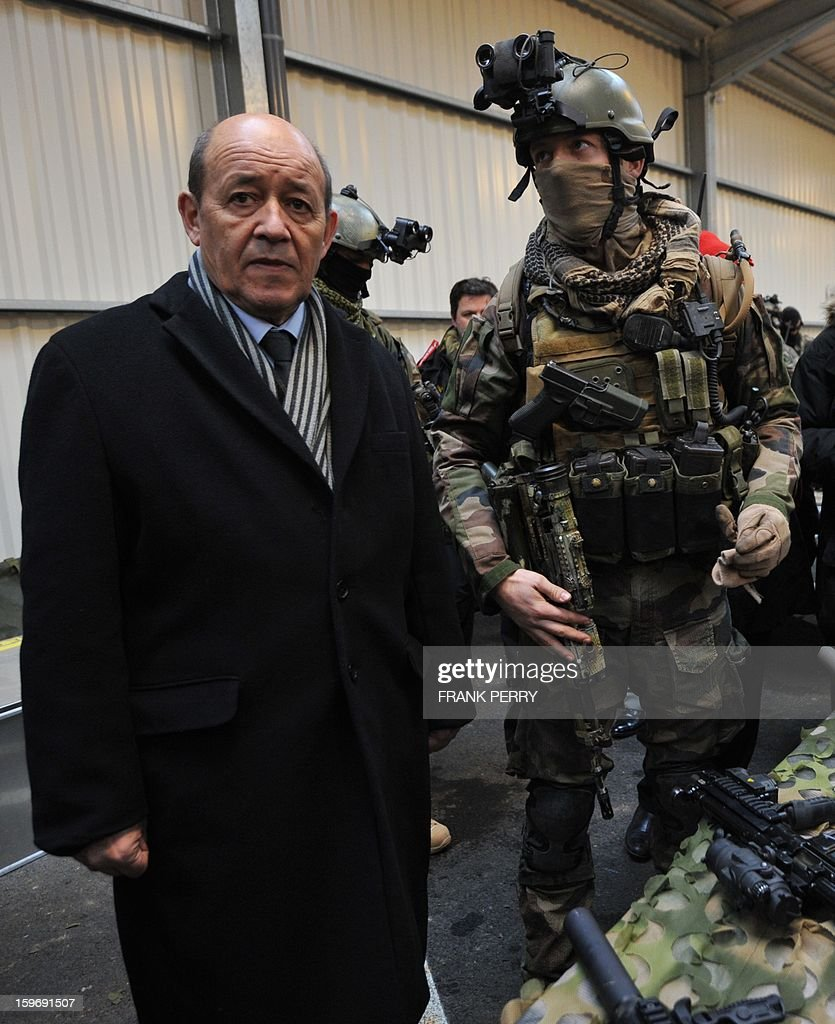 French Defense Minister Jean-Yves Le Drian (L) stands next to a member of the French special forces on January 18, 2013 during a visit to the sniper commando base in the northwestern French town of Lanester.