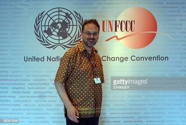 French delegate Paul Watkinson walks past a poster at the UN Climate Change Conference 2007 venue in Nusa Dua on Bali island 07 December 2007 In the...