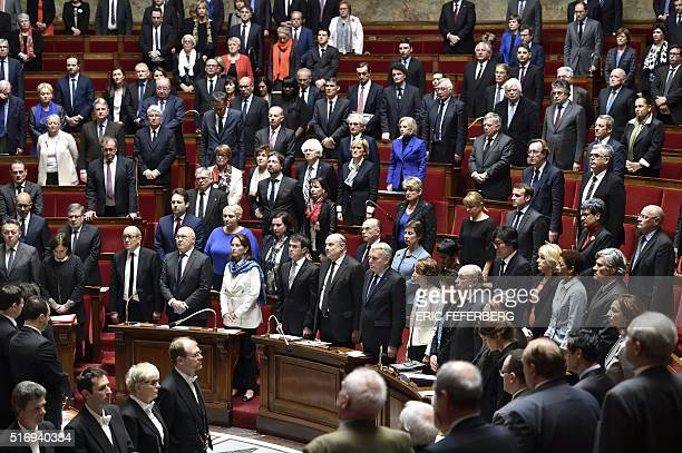 TOPSHOT French deputies hold a minute of silence for the victims of this morning's attacks in Brussels at the start of a session of questions to...