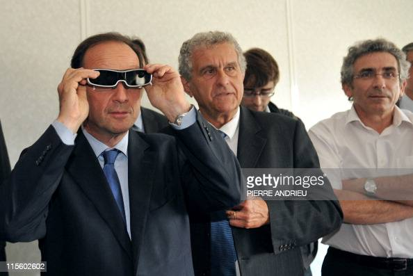French deputy Francois Hollande candidate for the 2011 Socialist primary elections before France's 2012 presidential elections flanked by i2S Vision...