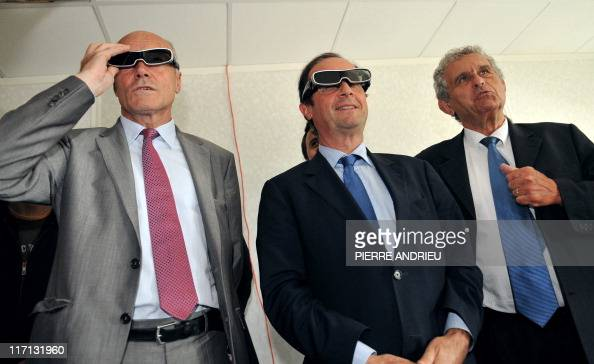 French deputy Francois Hollande candidate for the 2011 Socialist primary elections before France's 2012 presidential elections flanked by the...