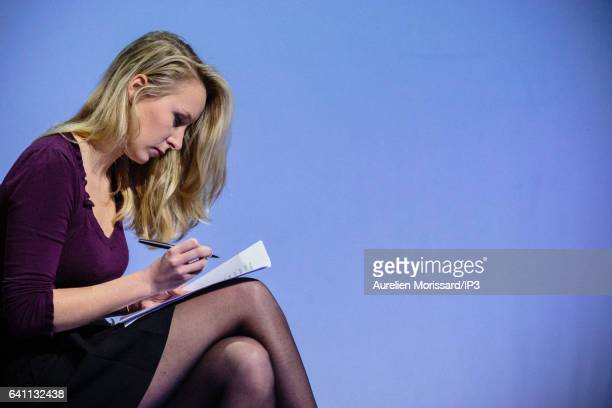 French Deputy Marion Marechal Le Pen is writing her speech Before climbing onto the platform to speak it during the 'Assises de la présidentielle' at...