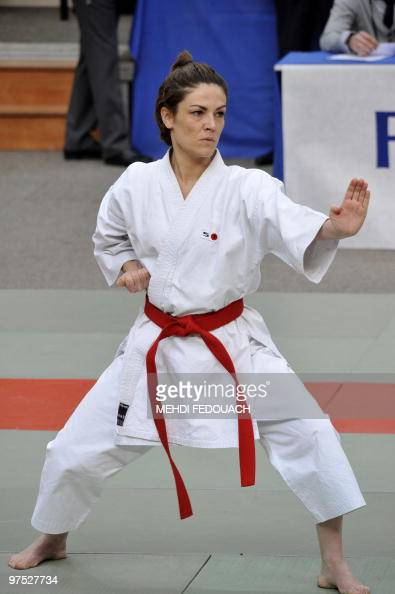 French deputy minister for Ecology and former Karatekata French champion Chantal Jouanno competes with her team in the French Karate team...