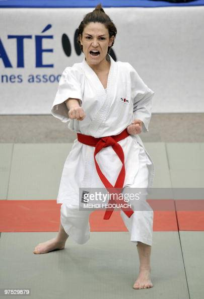 French deputy minister for Ecology and former Karatekata French champion Chantal Jouanno competes in the French Karate team championships on March 7...