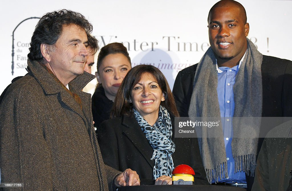 French deputy, <a gi-track='captionPersonalityLinkClicked' href=/galleries/search?phrase=Pierre+Lellouche&family=editorial&specificpeople=710423 ng-click='$event.stopPropagation()'>Pierre Lellouche</a> (L), Anne Hidalgo (C) and French Judoka <a gi-track='captionPersonalityLinkClicked' href=/galleries/search?phrase=Teddy+Riner&family=editorial&specificpeople=4114927 ng-click='$event.stopPropagation()'>Teddy Riner</a> (R) launch the Christmas Lights at Faubourg Saint-Honore on November 14, 2013 in Paris, France. Every year the committee of the Faubourg Saint-Honore Royal organizes the Faubourg St Honore illumination.