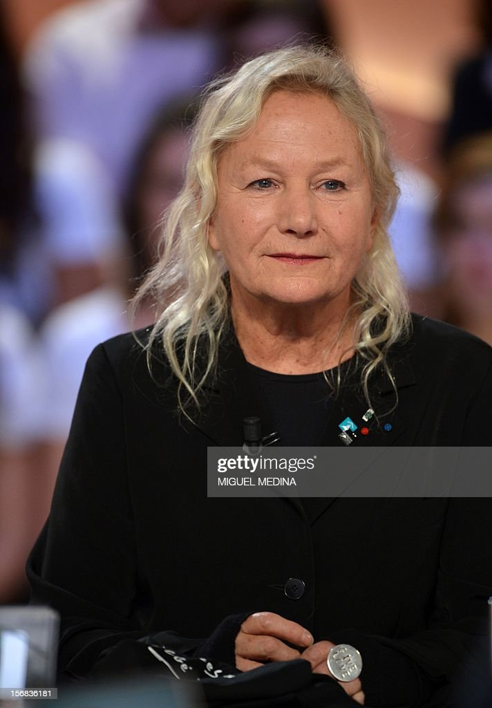 French designer Agnes B takes part in the TV show 'Le grand journal' on a set of French TV Canal+, on November 22, 2012 in Paris. Former French football player turned actor Eric Cantona hosted the TV show 'Le grand journal', as part of the launching of French charity association Abbe Pierre Foundation's winter campaign.
