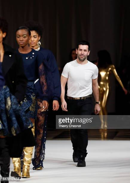 French designer Alexis Mabille acknowledges the audience after presenting his Fall/Winter 2017/18 Ready to Wear collection during the Paris Fashion...