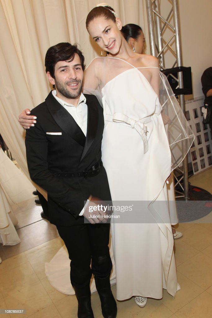 French designer Alexis Mabille poses with a model after his fashion show as part of the Paris Haute Couture Fashion Week Spring/Summer 2011 at Musee...