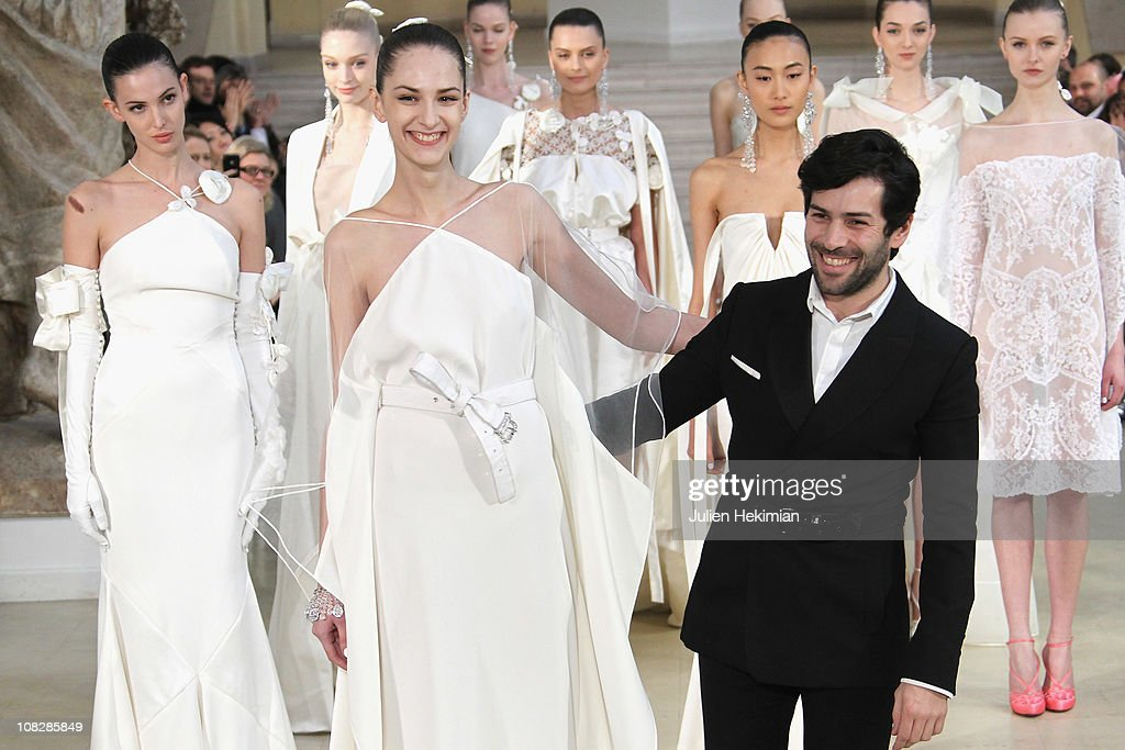 French designer Alexis Mabille salutes the crowd after his fashion show as part of the Paris Haute Couture Fashion Week Spring/Summer 2011 at Musee...