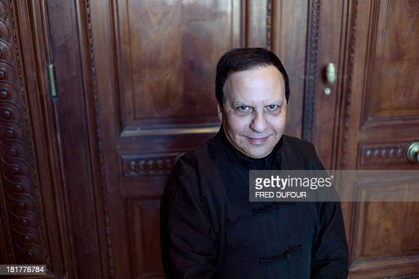 French designer Azzedine Alaia poses during his exhibition at the Palais Galliera on September 25 in Paris AFP PHOTO / FRED DUFOUR