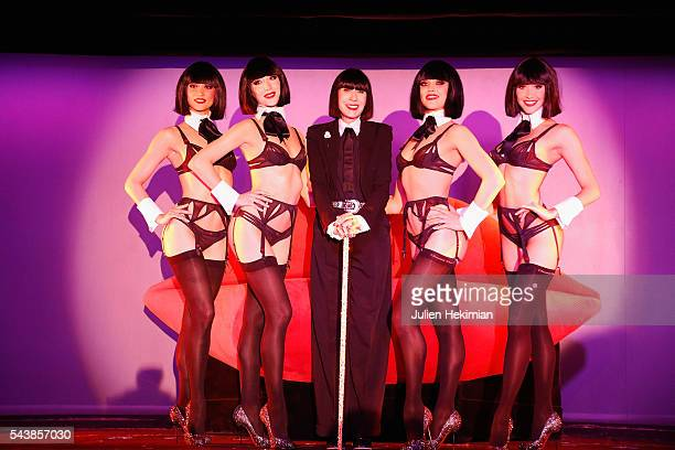 French Designer Chantal Thomass Crazy Horse new guest is pictured with the dancers at the end of the press conference at Le Crazy Horse on June 30...