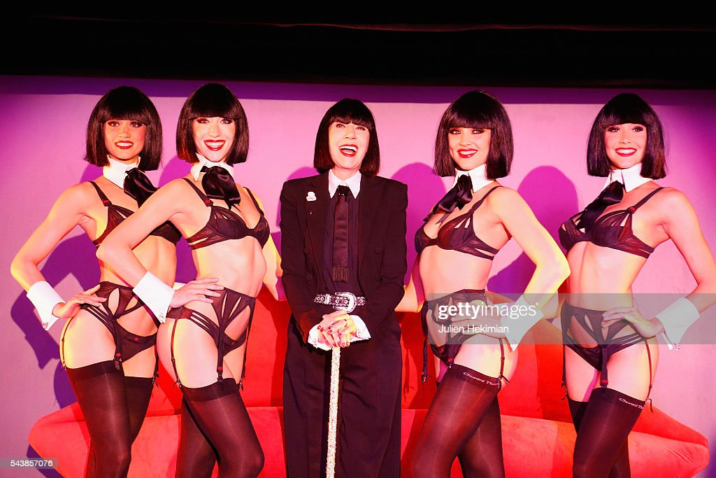 French Designer Chantal Thomass, Crazy Horse new guest, is pictured with the dancers at the end of the press conference at Le Crazy Horse on June 30, 2016 in Paris, France.