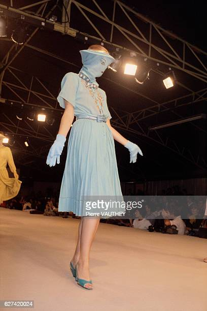 French designer Emmanuelle Khanh shows her 1980 springsummer women's readytowear collection in Paris The model who's face is covered with fabric is...