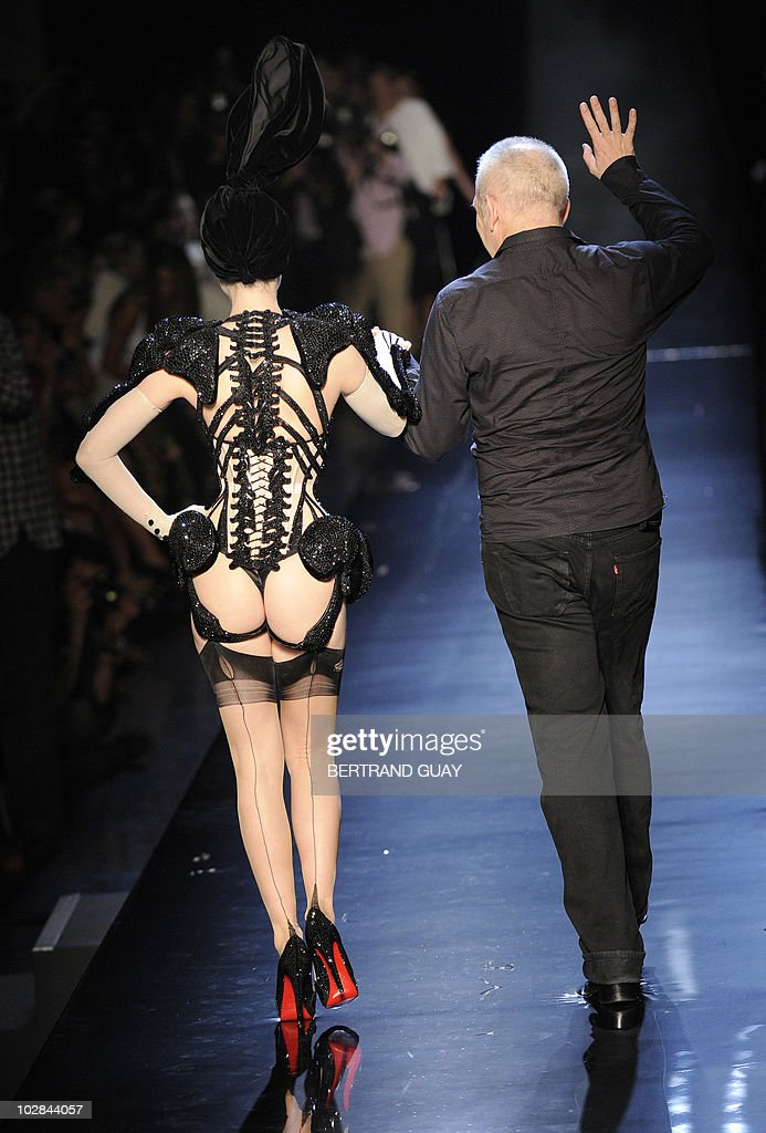 French designer <a gi-track='captionPersonalityLinkClicked' href=/galleries/search?phrase=Jean+Paul+Gaultier+-+Modedesigner&family=editorial&specificpeople=4310036 ng-click='$event.stopPropagation()'>Jean Paul Gaultier</a> and US dancer <a gi-track='captionPersonalityLinkClicked' href=/galleries/search?phrase=Dita+Von+Teese&family=editorial&specificpeople=210578 ng-click='$event.stopPropagation()'>Dita Von Teese</a> acknowledge the public at the end of the Fall/Winter 2010-2011 Haute Couture Collection Show, on July 7, 2010, in Paris.