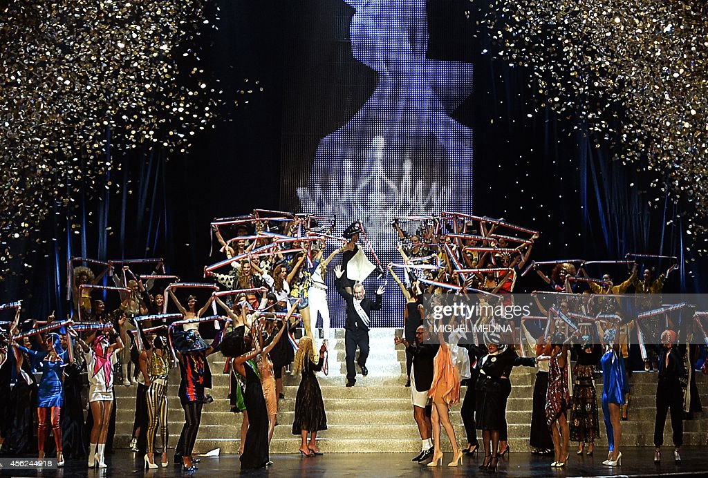 French designer Jean Paul Gaultier celebrates with models at the end of his last readytowear collection the 2015 Spring/Summer readytowear collection...