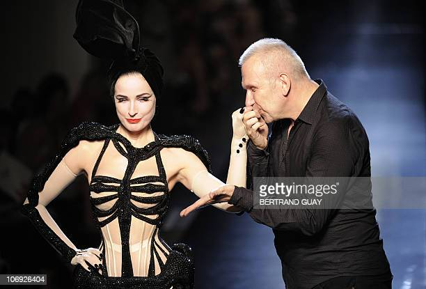 French designer Jean Paul Gaultier kisses US dancer Dita Von Teese after his Fall/Winter 20102011 Haute Couture Collection Show on July 7 in Paris...