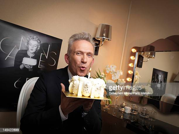 French designer JeanPaul Gaultier a film festival judge is photographed for Paris Match magazine in the Mouton Cadet Wine Bar in Cannes France He is...