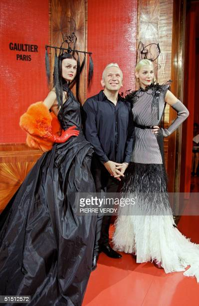 French designer JeanPaul Gaultier acknowledges the audience after his show 08 July 2001 in Paris during the AutumnWinter 2001/2002 haute couture...