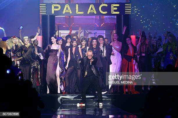 TOPSHOT French designer JeanPaul Gaultier acknowledges the audience at the end of his show during the 2016 spring/summer Haute Couture collection on...