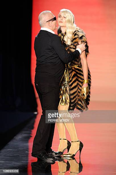 French designer JeanPaul Gaultier kisses Australian model Andrej Pejic holding a gun at the end of his Men's fallwinter 20112012 readytowear...