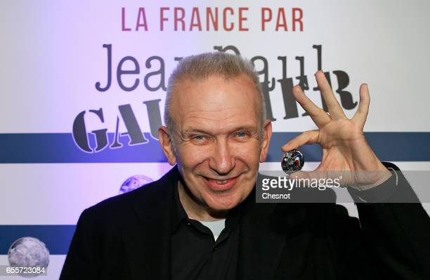 French designer JeanPaul Gaultier shows a coin during the launch of a serie of collection limited coins on March 20 2017 in Paris France 'La Monnaie...