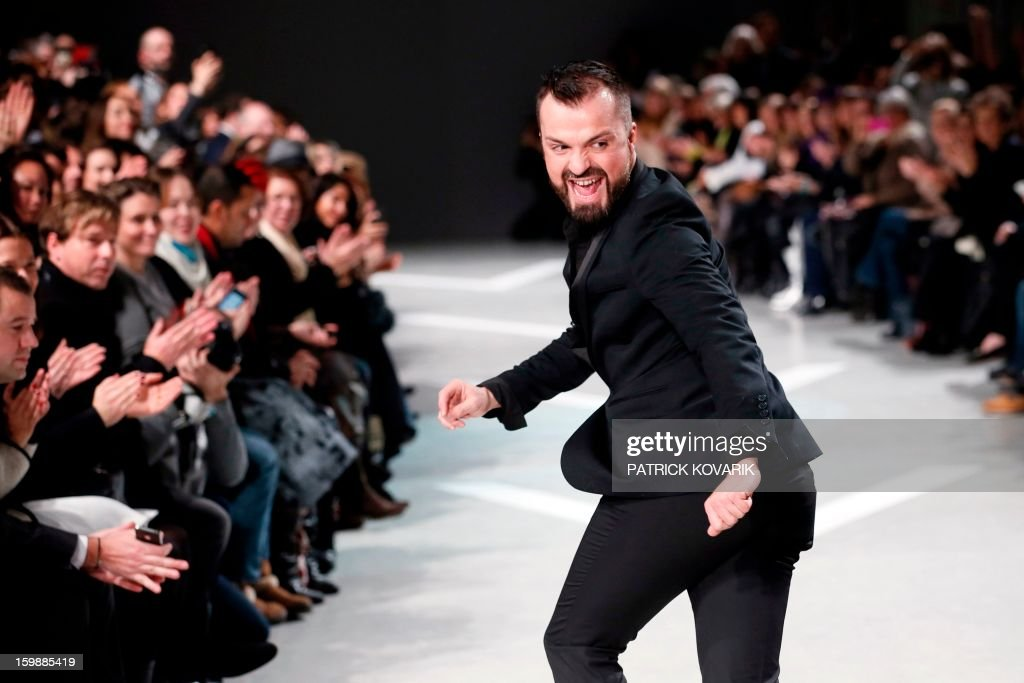 French designer Julien Fournie acknowledges the public at the end of his Haute Couture Spring-Summer 2013 collection show on January 22, 2013 in Paris.