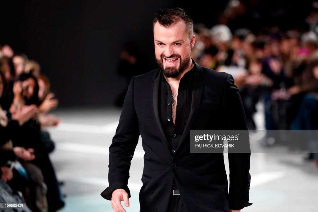 French designer Julien Fournie acknowledges the public at the end of his Haute Couture Spring-Summer 2013 collection show on January 22, 2013 in Paris. AFP PHOTO / PATRICK KOVARIK