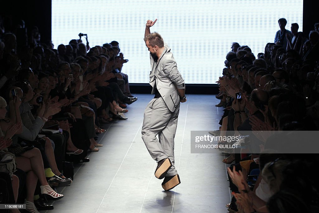 French designer Julien Fournie jumps as he acknowledges the public at the end of the Fall/Winter 2011-2012 Haute Couture Collection Show on July 5, 2011 in Paris. AFP PHOTO/FRANCOIS GUILLOT