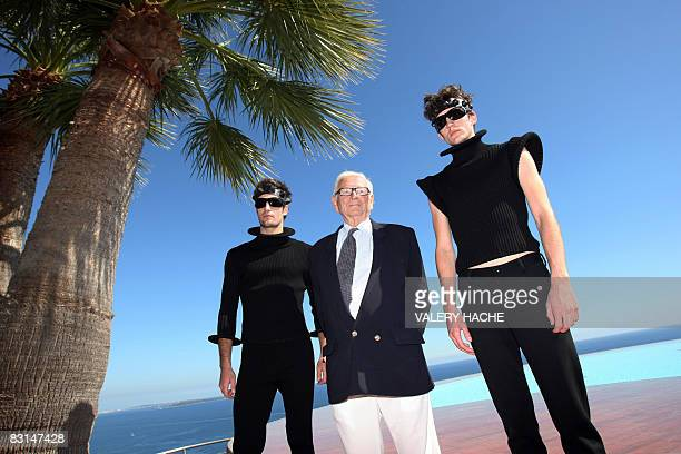 French designer Pierre Cardin poses with models after is spring/summer 2009 readytowear collection show in TheouleSurMer southern France on October 6...