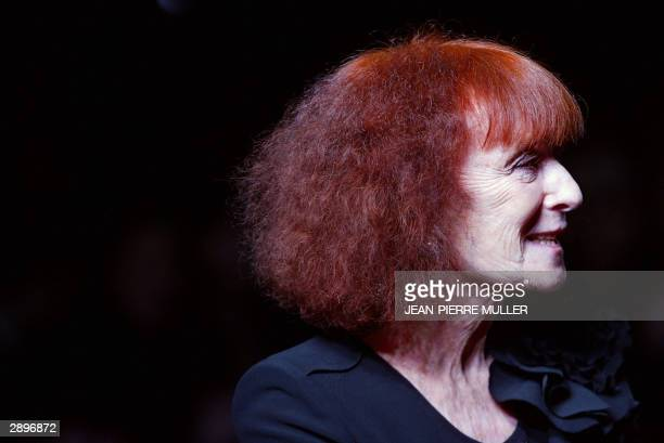 French designer Sonia Rykiel greets the crowd at the end of her show for the Autumn/Winter 20042005 Men's Fashion Week in Paris 24 January 2004 AFP...