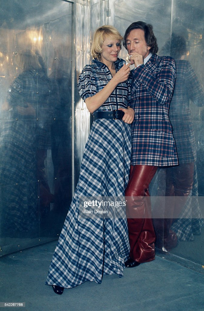 French designer Ted Lapidus with a model wearing his 1973 spring-summer collection.