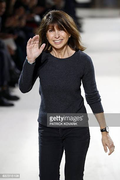 French designer Veronique Nichanian acknowledges the public at the end of the Hermes show during men's Fashion Week for the Fall/Winter 2017/2018...