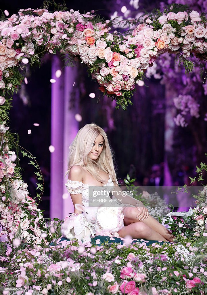 French designer Zahia Dehar arrives on a horse cart at the end of her show on the sidelines of the Haute Couture Spring-Summer 2013 collection presentations on January 23, 2013 in Paris.