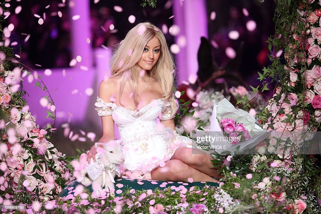 French designer Zahia Dehar arrives on a horse cart at the end of her show the Zahia Lingerie Spring/Summer 2013 Haute-Couture show as part of Paris Fashion Week at Palais De Tokyo on January 23, 2013 in Paris, France.