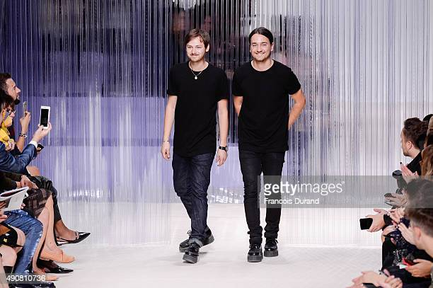 French designers Alexis Martial and Adrien Caillaudaud acknowledge the public at the end of the the Carven show as part of the Paris Fashion Week...