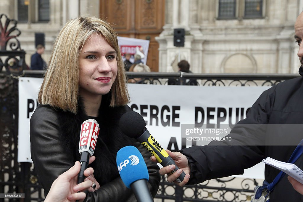 French Diane Lazarevic, the daughter of French hostages in Mali, Serge Lazarevic, anwers journalists' questions during a demonstration in support to businessman Philippe Verdon and engineer Lazarevic, two French hostages in Mali, on November 24, 2012 in front of Paris' city hall, to mark the first anniversary of their abduction. Thirteen hostages are held by hardline Islamists in the region which has suffered a devastating collapse since a coup in Bamako in March. Seven of these are French.