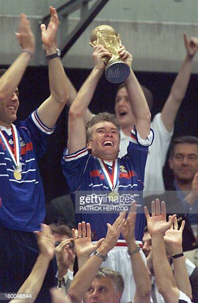French Didier Deschamps waves the FIFA trophy 12 July at the Stade de France in SaintDenis near Paris after winning the 1998 Soccer World Cup final...