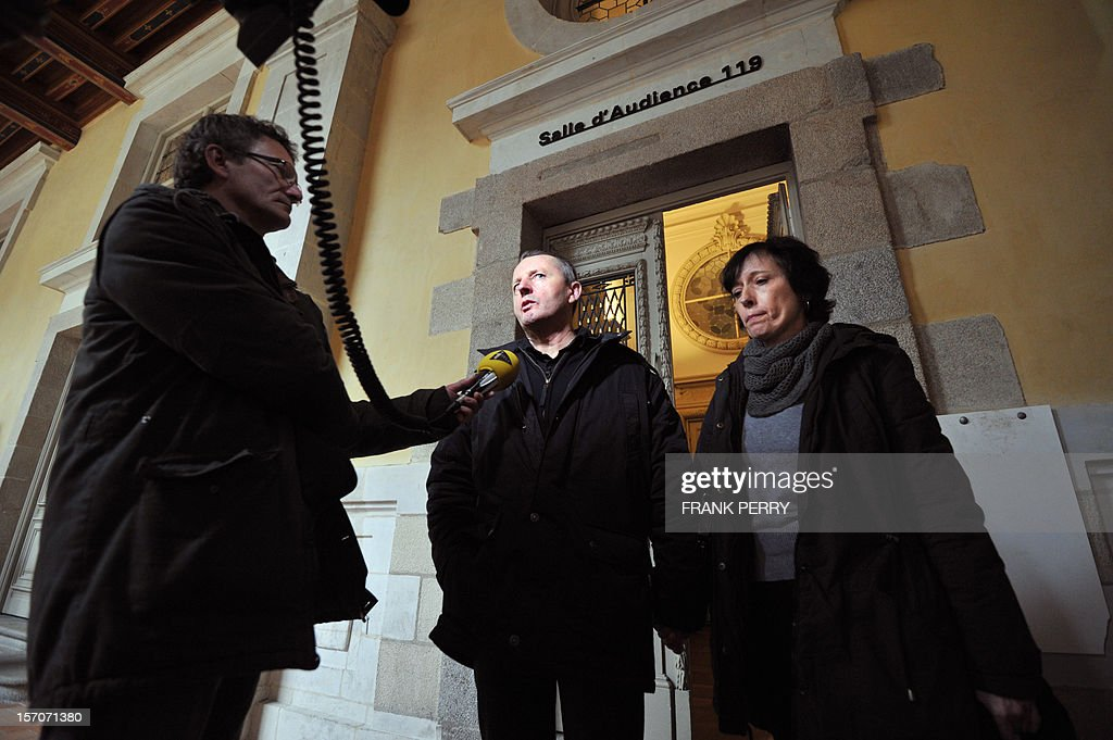 French Didier Jambart (C), flanked by his wife Christine Jambart, answers to a journalist as he leaves the courthouse in Rennes, western France, on November 28, 2012, after the appeal court rendered its verdict. The court upheld a ruling ordering pharmaceutical giant, British GlaxoSmithKline to pay 197,000 euros (some 254,000 US dollars) to Didier Jambart who claimed that the drug Requip to treat Parkinson's turned him into a gay sex and gambling addict. PERRY