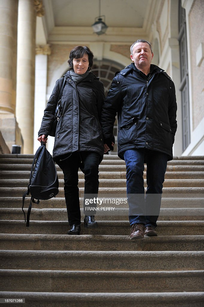 French Didier Jambart (R), flanked by his wife Christine Jambart, leaves the courthouse in Rennes, western France, on November 28, 2012, after the appeal court rendered its verdict. The court upheld a ruling ordering pharmaceutical giant, British GlaxoSmithKline to pay 197,000 euros (some 254,000 US dollars) to Didier Jambart who claimed that the drug Requip to treat Parkinson's turned him into a gay sex and gambling addict. PERRY